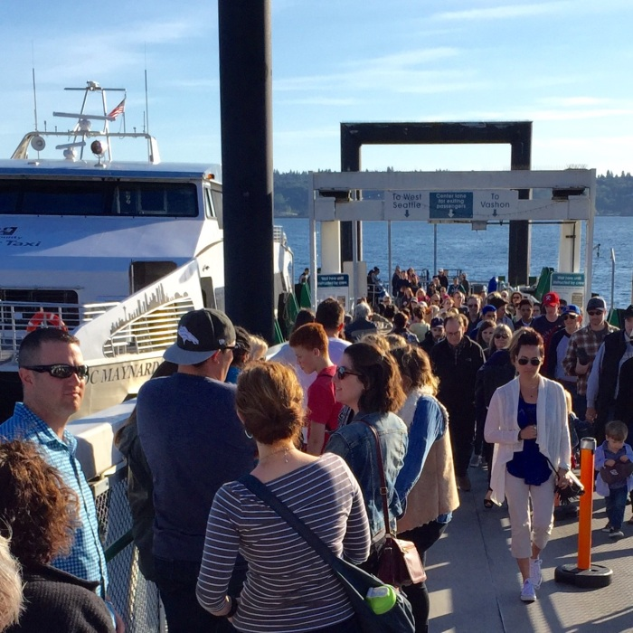 Pier 50 with many passengers waiting to board as others exit the Water Taxi.