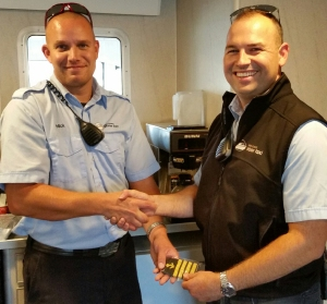 Nick Williams above on left receiving Captains epaulets from Deckhand/Relief Captain GW Rogers