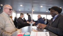 Mike Sudduth, left, plays a game of cribbage with Richard Franklin, right, as another game of cribbage takes place at the table next to them aboard the MV Sally Fox. Sudduth donated the specially inscribed boards as a way to honor his friend, Sally Fox, who was an advocate for passenger-only ferry service to Vashon Island and the vessel's namesake.