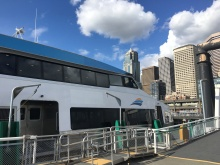 The MV Sally Fox awaits passengers at Pier 50 with the Seattle skyline in the background.