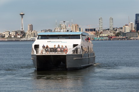 With the iconic Space Needle in the background, the Doc Maynard glides the waters of Puget Sound between Downtown and West Seattle.