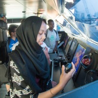 Students with Woodland Park Zoo's Summer Youth Climate Action Network visit the wheelhouse of a King County Water Taxi vessel.