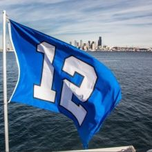 A Seahawks' 12th Man flag flies aboard the King County Water Taxi.