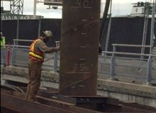 A construction worker oversees installation of a template pile Oct. 11 at King County Water Taxi's future POF facility. It is the first phase of the five-year, Seattle Multimodal Terminal at Colman Dock Proect.