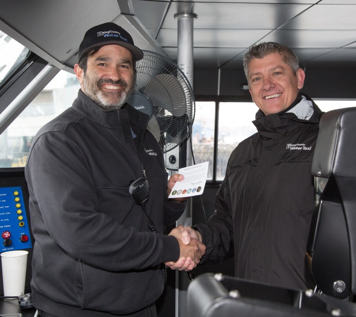 Captain Neal Amaral receives his Veterans Day pin from Ron Panzero, Marine Operations and Maintenance Manager for King County Water Taxi.
