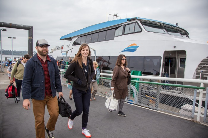 Riders from Vashon Island disembark the MV Sally Fox in Seattle.