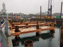 Crews install falsework at the future site of King County Water Taxi Passenger Only Ferry (POF) facility on the Seattle waterfront.