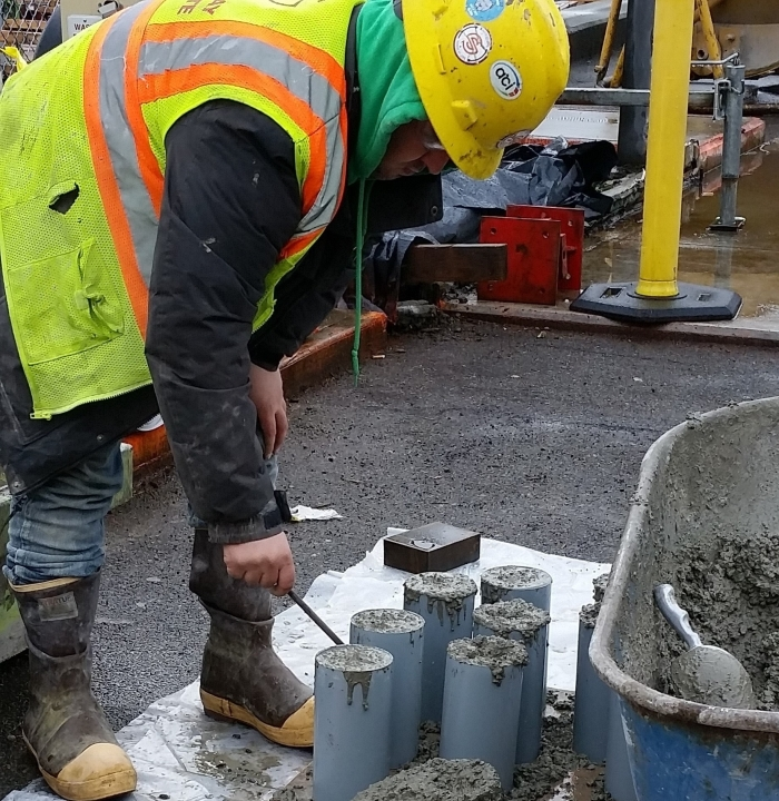 A worker adjusts recently poured concrete on top of a piling at King County Water Taxi's future Passenger Only Ferry (POF) facility at Colman Dock. The procress, known as capping, will help connect the piles to the trestle and passenger deck of the facility.