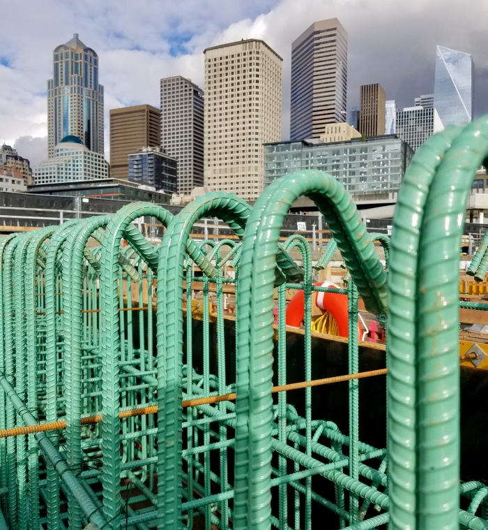Rebar at the future home of the King County Water Taxi with the Seattle skyline in the background.