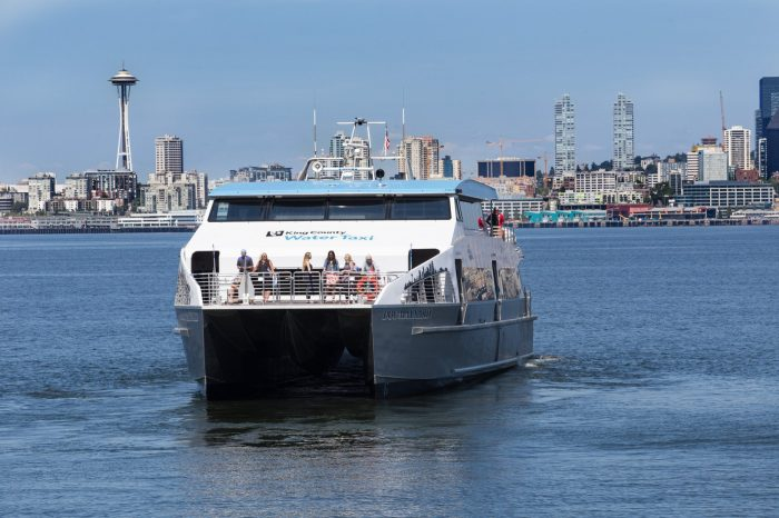 With Seattle's famed Space Needle in the background, the MV Doc Maynard glides across Elliott Bay toward West Seattle.