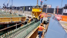 Crews work near the future King County Water Taxi passenger ferry terminal in Seattle