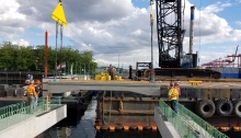 Crews install the first deck slabs of King County Water Taxi's future Passenger Only Ferry (POF) facility in July 2018.