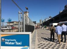 A King County Water Taxi sign greets passers-by of the service's temporary facility at Pier 52
