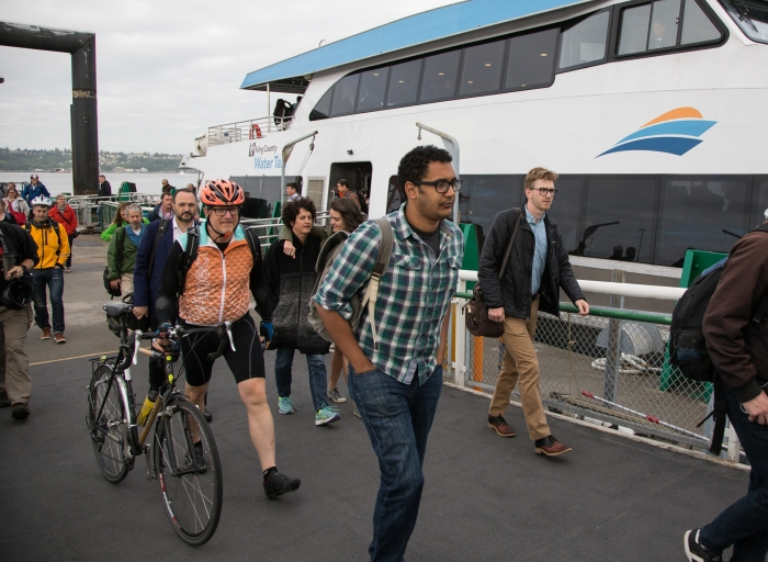 A group of riders from Vashon Island - including a bicylist - disembark the MV Sally Fox after it arrives at Pier 52 on the Seattle waterfront.