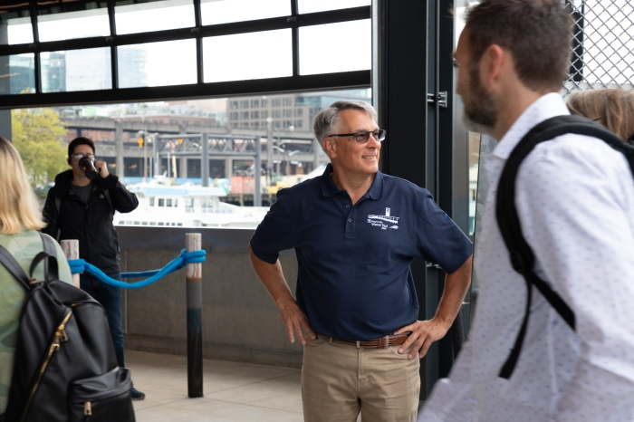 Marine Division Director Paul Brodeur greeting passengers disembarking from the Water Taxi