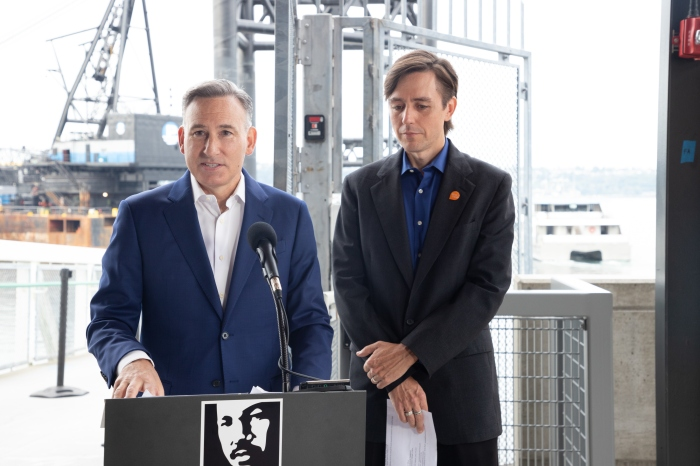 King County Executive Dow Constantine speaking at a press conference in Pier 50 on opening day, with Bainbridge Island Mayor Kol Medina