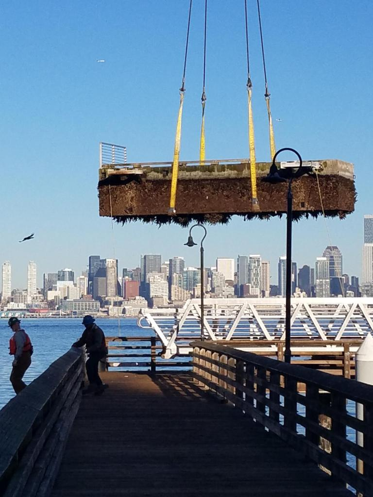 A crane removes the old dock